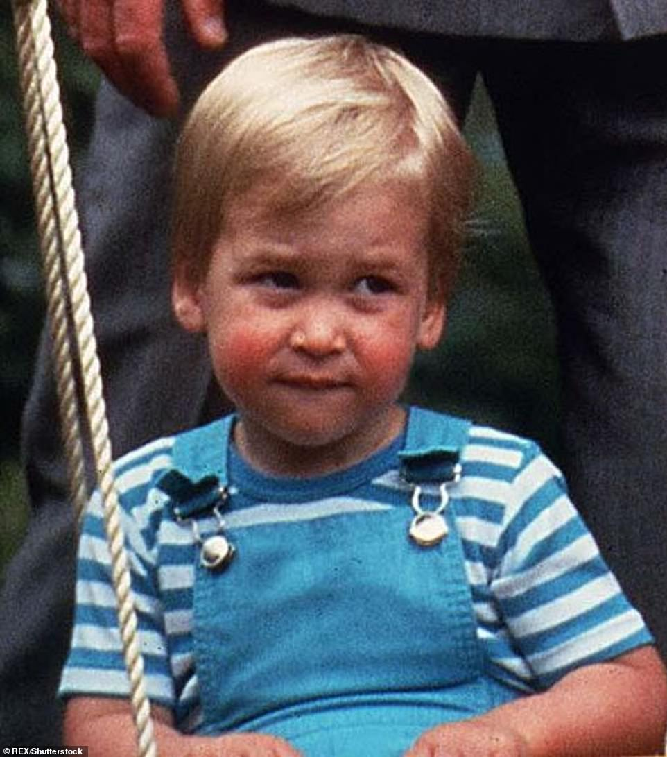 A chip off the old block: Prince William, pictured on his 2nd birthday, has the same rosy cheeks and mischievous look as his youngest son