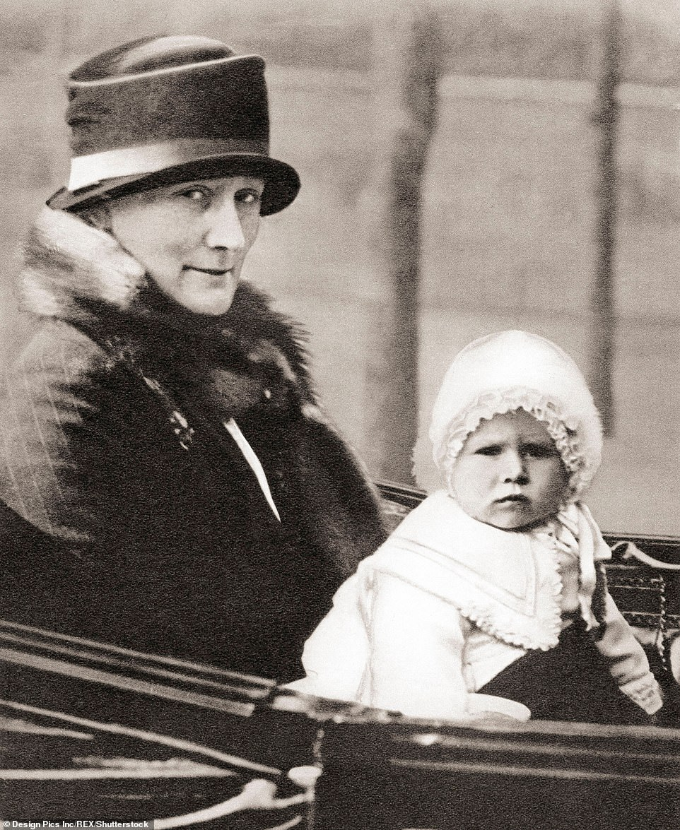 The future Queen Elizabeth II, born 1926, seen here in 1928 aged two with her nanny, Clara Knight, known as 'Allah'