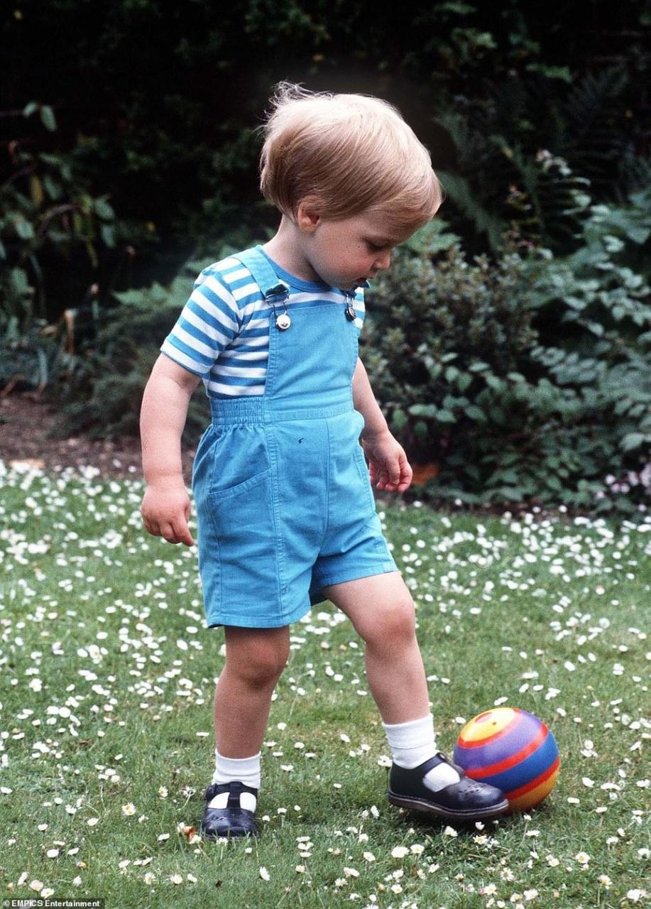 A young Prince William on his second birthday playing football, in the gardens of Kensington Palace, June 1984