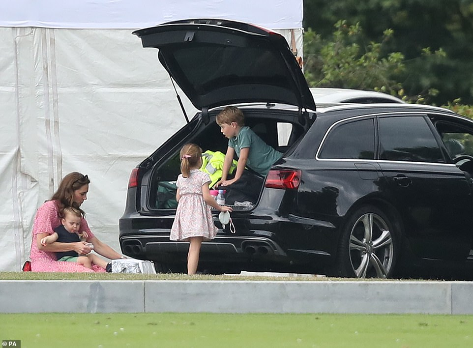 The Duchess of Cambridge, Prince George, Princess Charlotte and Prince Louis attending the King Power Royal Charity Polo Day at Billingbear Polo Club, Wokingham, Berkshire, in July 2019