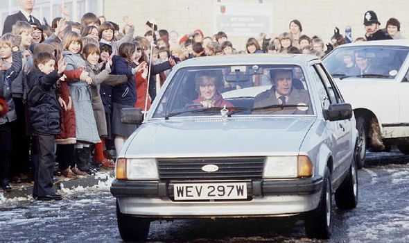 Princes Diana behind the wheel of her Ford Escort(Image: Getty)